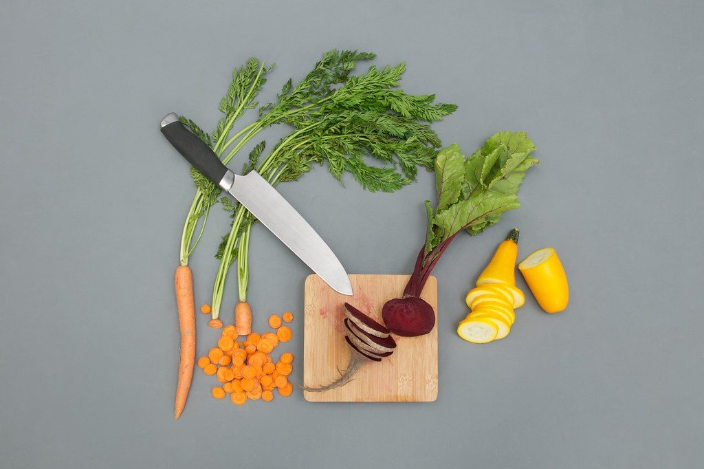 cutting board with chopped vegetables
