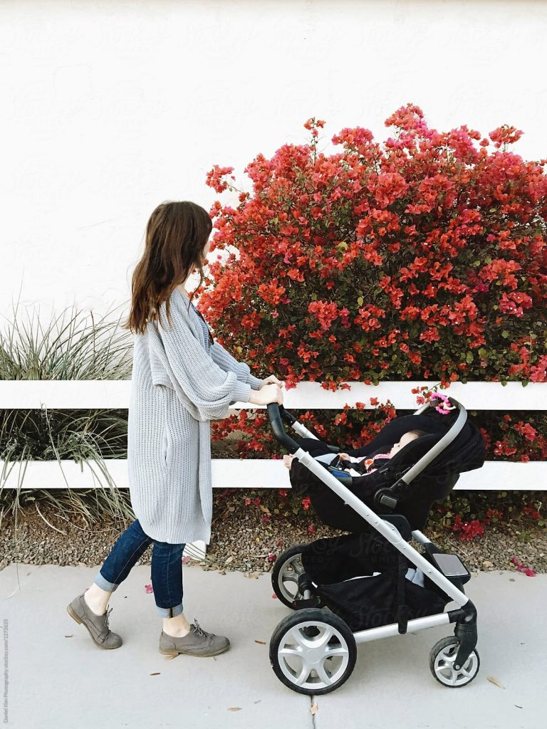 Mom pushing baby in a stroller