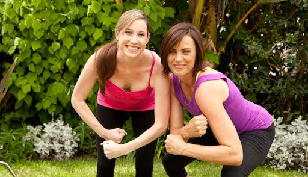 a mom and her daughter working out