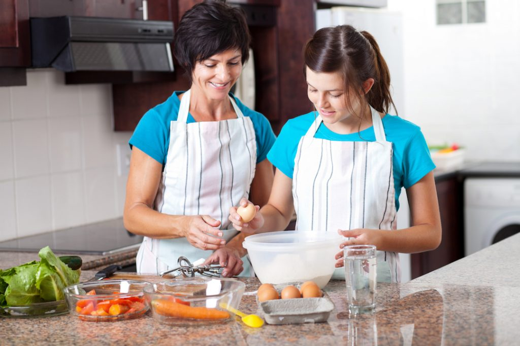 Mom and daughter make a meal together