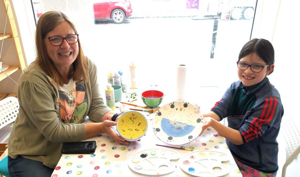 Mom and daughter doing pottery